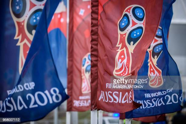 Flags featuring the logo of the FIFA World Cup 2018 are seen outside Rostov Arena in the southern Russian city of RostovonDon on May 13 2018 The...