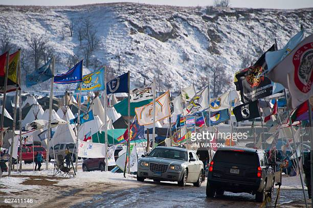 Flags flap in the wind on the main thoroughfare of Oceti Sakowin Camp on the edge of the Standing Rock Sioux Reservation on December 3 2016 outside...