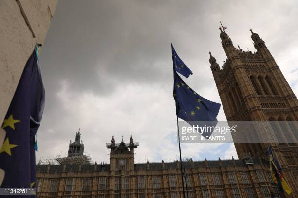 EU flags flutter near the Houses of Parliament in central London on April 3 2019 Prime Minister Theresa May was to meet on Wednesday with the leader...