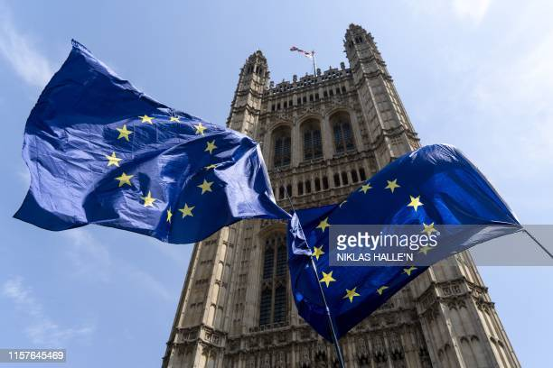 EU flags flutter on the day of Britain's newly elected prime minister Boris Johnson's debut in the House of Commons outside the Houses of Parliament...