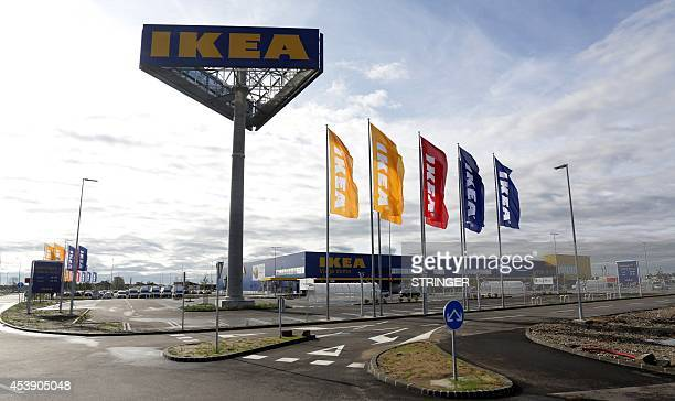 IKEA flags flutter outside the newly opened IKEA store near Zagreb on August 21 2014 Swedish furniture giant IKEA opened its first store in the...