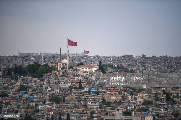 Flags flutter over Gaziantep in the southwest province of Turkey on May 1 2018 In the Turkish city of Gaziantep home to around half a million Syrians...