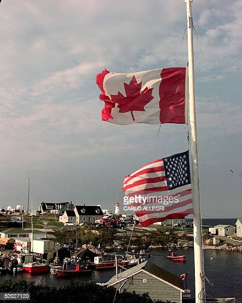 Flags fly 06 September at half mast in honor of the victims of the crash of Swissair Flight 111 at Peggy's Cove Nova Scotia The Swissair plane...