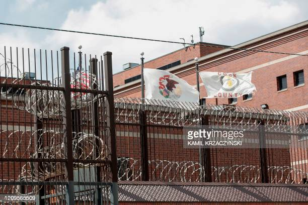 Flags fly above barbed wire at the Cook County Department of Corrections housing one of the nation's largest jails is seen in Chicago Illinois on...