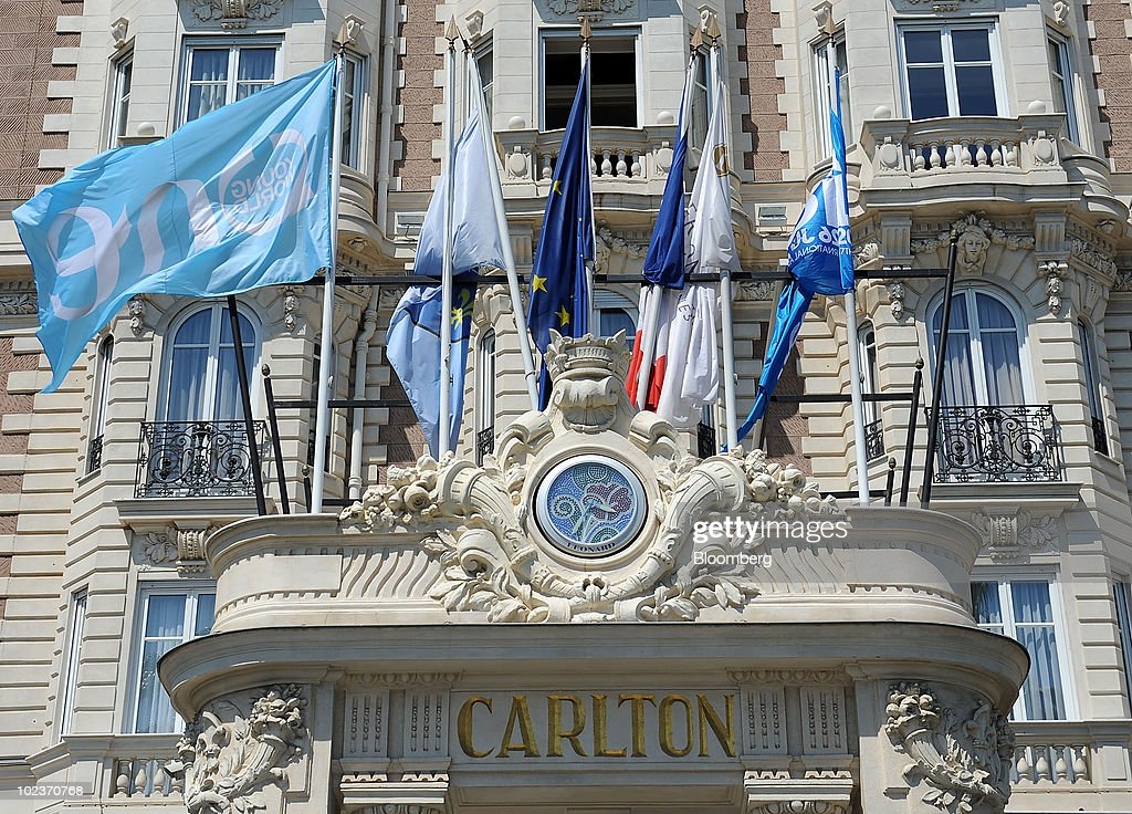 Flags Fly Above The Entrance To Intercontinental Hotels Group Plc Carlton Hotel In Cannes