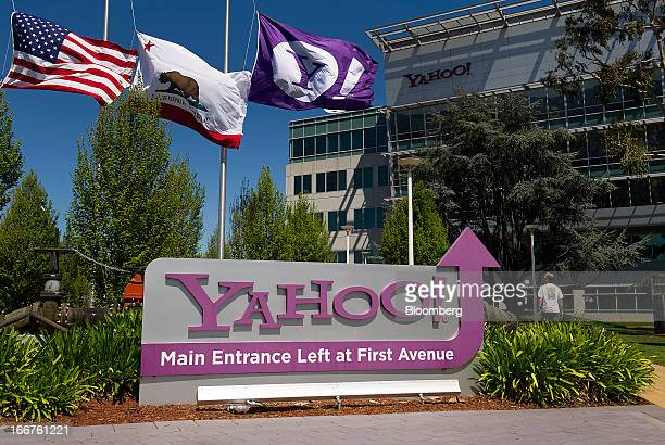 Flags fly above Yahoo Inc signage displayed at the company's headquarters in Sunnyvale California US on Tuesday April 16 2013 Yahoo Inc the biggest...