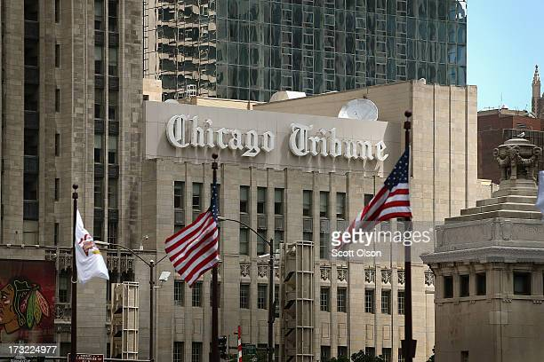 Flags fly along the Michigan Avenue bridge near the Tribune Tower home of the Chicago Tribune WGN Radio and the Tribune Company on July 10 2013 in...