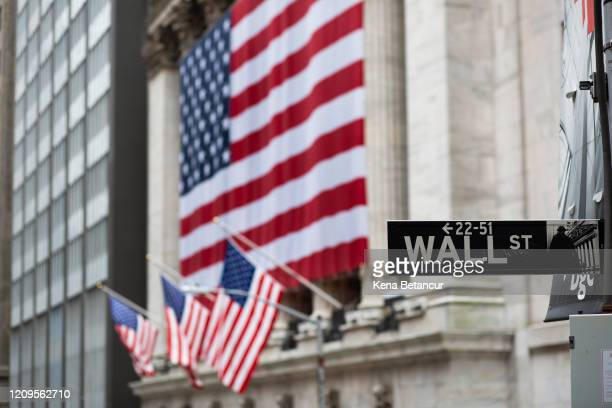 Flags fly at full staff outside the NYSE on April 09, 2020 in New York City. Gov. Andrew Cuomo directed flags to be flown at half-staff for the...