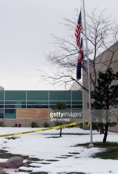 Flags fly at half mast in front of Columbine High School in Littleton CO 22 April the site where fourteen students and one teacher were killed 20...