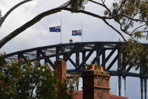 AUS: Flags At Half Mast On Sydney Harbour Bridge In Tribute To Dean Jones