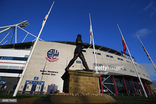 Flags fly at half mast in memory of former Bolton Wanderers Chairman Phil Gartside at Macron Stadium on February 11 2016 in Bolton England