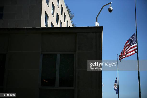 Flags fly at half staff outside the State Department September 12, 2012 in Washington, DC. U.S. Ambassador to Libya J. Christopher Stevens and three...