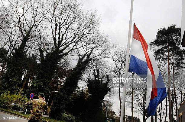 Flags fly at halfmast at a military base in Ermelo on April 18 2008 The son of the Netherland's newlyswornin army chief Peter van Uhm was killed in a...