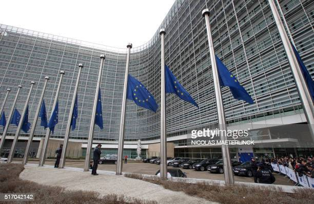 EU flags fly at halfmast at the European Commission headquarters in Brussels on March 23 a day after blasts hit the Belgian capital World leaders...