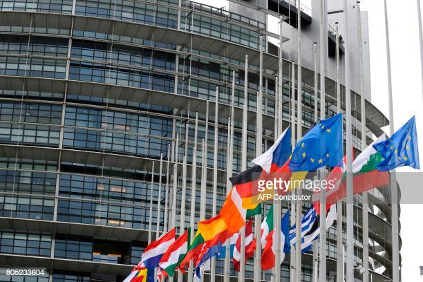 Flags fly at halfmast at the European Parliament in Strasbourg eastern France on July 1st 2017 before a ceremony in tribute to former German...