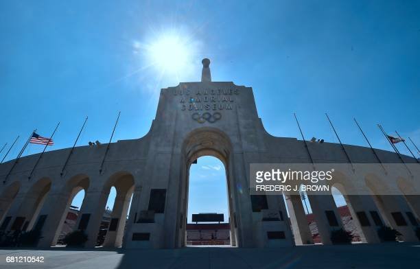 US flags fly at the Los Angeles Memorial Coliseum on May 9 as the International Olympic Committee evaluation committee visits Los Angeles ahead of...