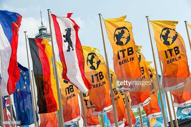 Flags fly at the main entrance of the Berlin Fair during the opening day of the 50th International Tourism Trade Fair in Berlin Germany on March 9...