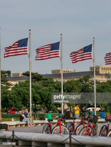Flags fly at the Washington Monument in the heart of the Capitol Mall on June 4 2017 in Washington DC The nation's capital the sixth largest...