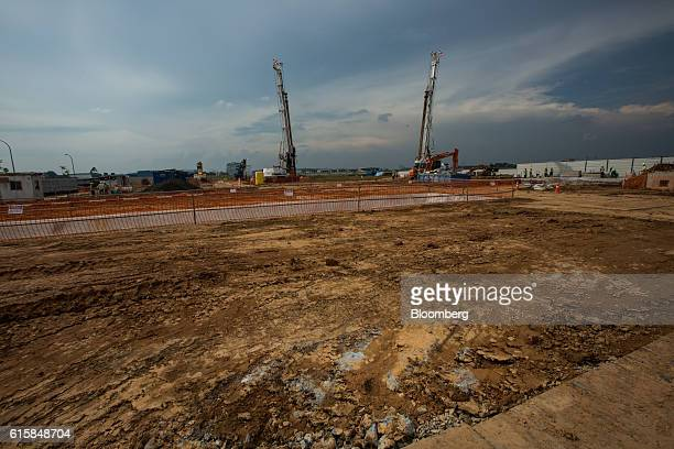 Flags fly atop cranes on a construction site during a groundbreaking ceremony for Seletar Airport's new passenger terminal in Singapore on Thursday...