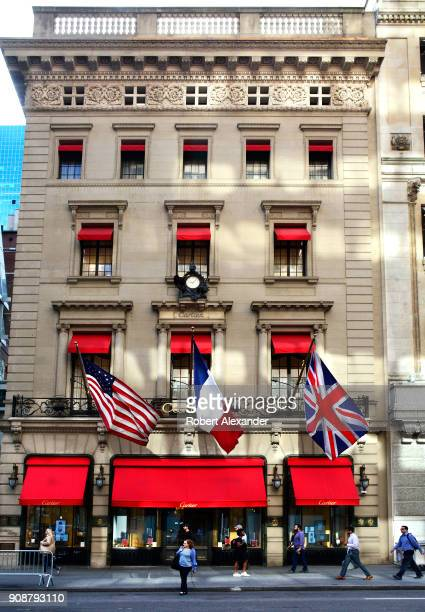Flags fly from the Cartier Building on Fifth Avenue in New York City. Now known as the Cartier Building, the Manhattan landmark was originally the...