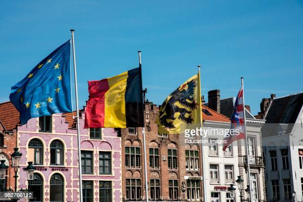 Flags fly in Bruge Belgium central market