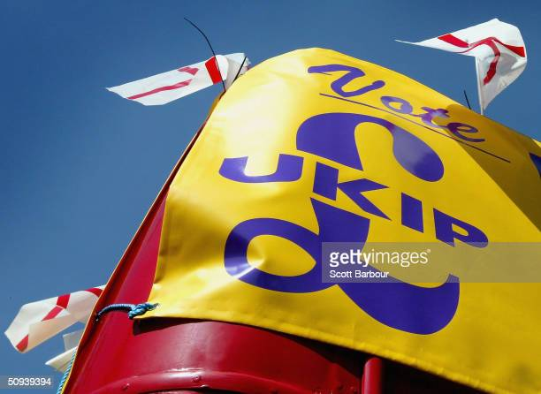 Flags fly in the air as Frank Maloney the London mayoral candidate from the UK Independence Party campaigns from a red double decker bus on June 8...