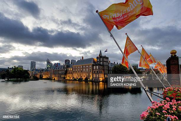 Flags fly in the early morning at the Binnenhof at The Hague the Netherlands on September 15 on Prinsjesdag the traditional opening of the Dutch...