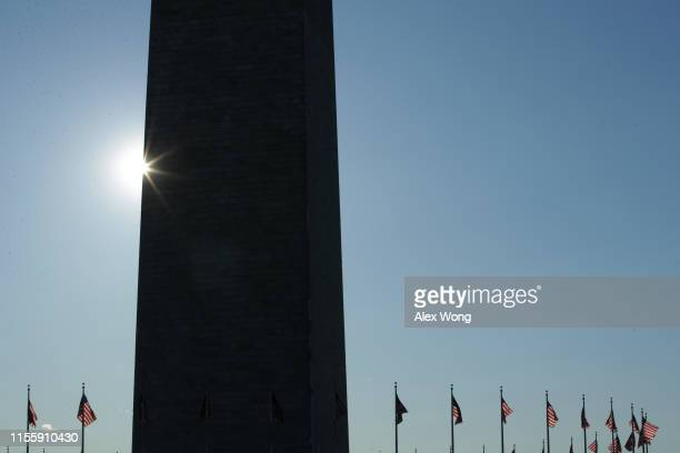 S flags fly near of the Washington Monument on Flag Day June 14 2019 in Washington DC The nation observes the Flag Day that commemorates the adoption...