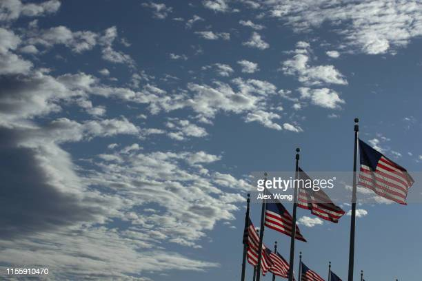 S flags fly near the Washington Monument on Flag Day June 14 2019 in Washington DC The nation observes the Flag Day that commemorates the adoption of...