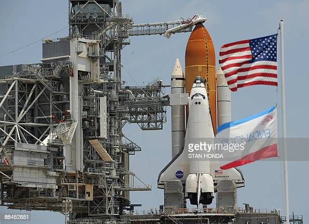Flags fly near US space shuttle Endeavour on Pad 39A on June 12, 2009 at Kennedy Space Center in Florida. Endeavour is scheduled for an early morning...