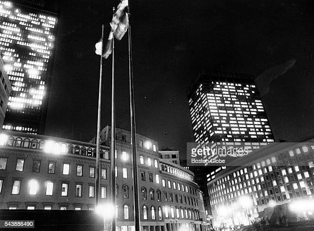 Flags fly on City Hall Plaza in Boston at night on Oct 31 1986