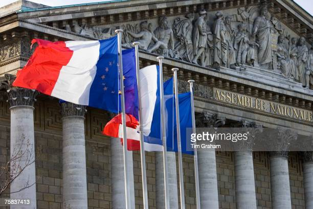 Flags fly on flagpoles outside Assemble Nationale Palais Bourbon Central Paris France