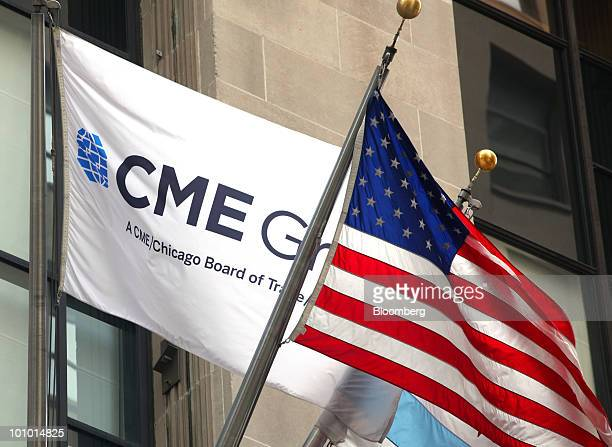 Flags fly on the front facade of CME Group Inc's Chicago Board of Trade in Chicago CBOT in Chicago Illinois US on Thursday May 20 2010 CME Group...