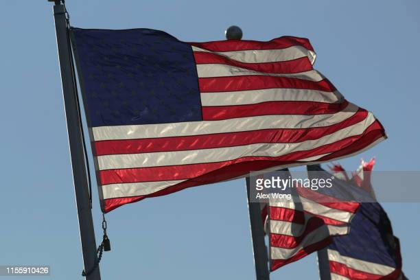 S flags fly on the ground of the Washington Monument on Flag Day June 14 2019 in Washington DC The nation observes the Flag Day that commemorates the...