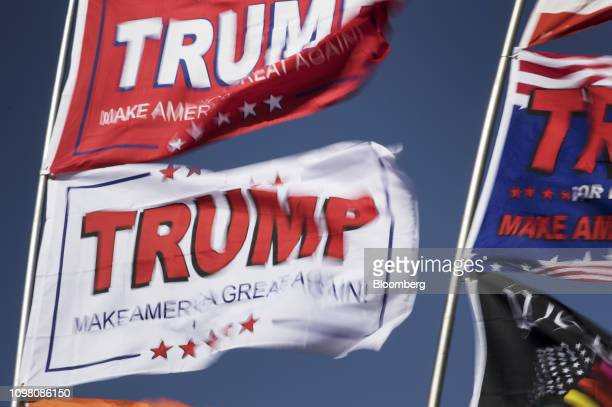 Flags fly outside a rally for US President Donald Trump in El Paso Texas US on Monday Feb 11 2019 Trumpand prospective Democratic challengerBeto...