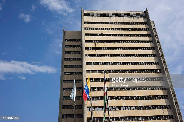 Flags fly outside a Valle del Cauca state government building in Cali Colombia on Wednesday Aug 12 2015 Colombia's central bank last month cut its...