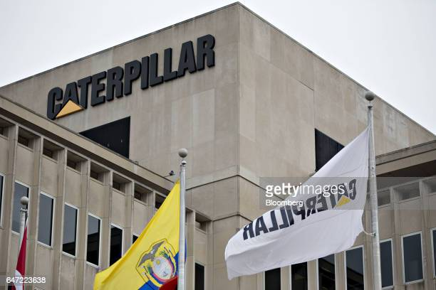 Flags fly outside Caterpillar Inc headquarters in Peoria Illinois US on Thursday March 2 2017 Caterpillar Inc shares headed for the steepest decline...