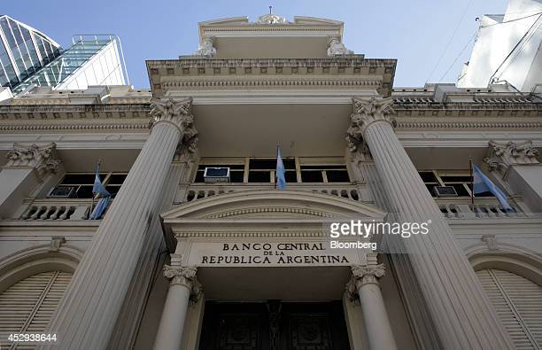 Flags fly outside the central bank of Argentina in Buenos Aires Argentina on Wednesday July 30 2014 A top Argentine banker and former Economy...
