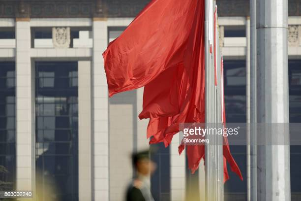 Flags fly outside the Great Hall of the People during the 19th National Congress of the Communist Party of China in Beijing, China, on Thursday, Oct....