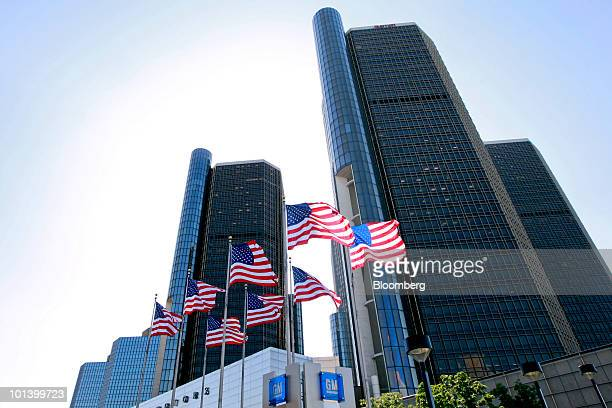 Flags fly outside the headquarters building of General Motors Co. In Detroit, Michigan, U.S., on Tuesday, June 1, 2010. General Motors Corp. Filed...