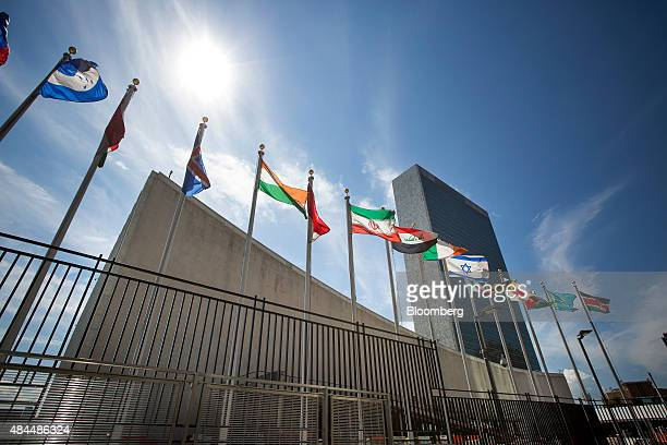 Flags fly outside the the United Nations headquarters in New York US on Wednesday Aug 5 2015 The 70th UN General Assembly is scheduled to open in New...