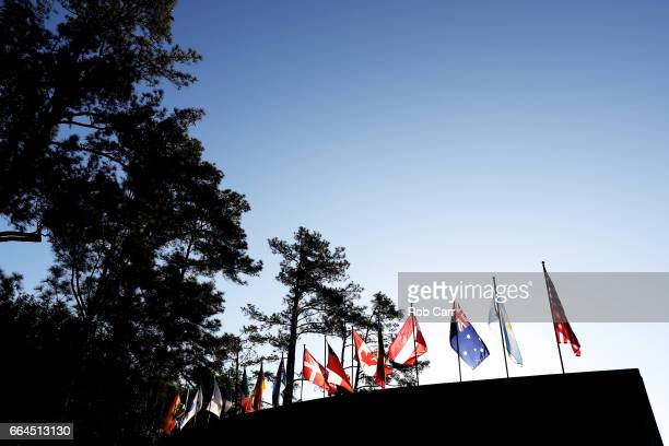 Flags fly over a grandstand during a practice round prior to the start of the 2017 Masters Tournament at Augusta National Golf Club on April 4 2017...