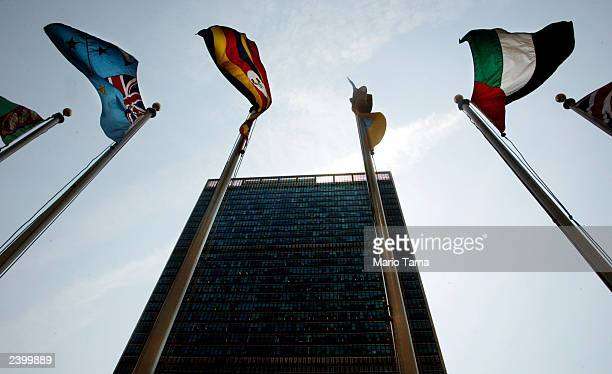 Flags fly over United Nations Headquarters August 14 2003 in New York City Lawyers for Libya and families of the victims of the 1988 Pan Am bombing...