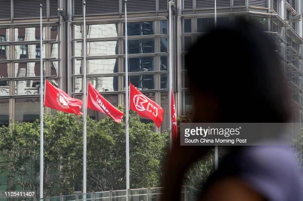 Flags flying at halfmast outside Cheung Kong Center in Central after a HK Electric ferry sunk at the water off Lamma Island on Monday 02OCT12
