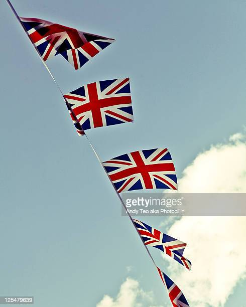 flags flying high - bunting stock pictures, royalty-free photos & images