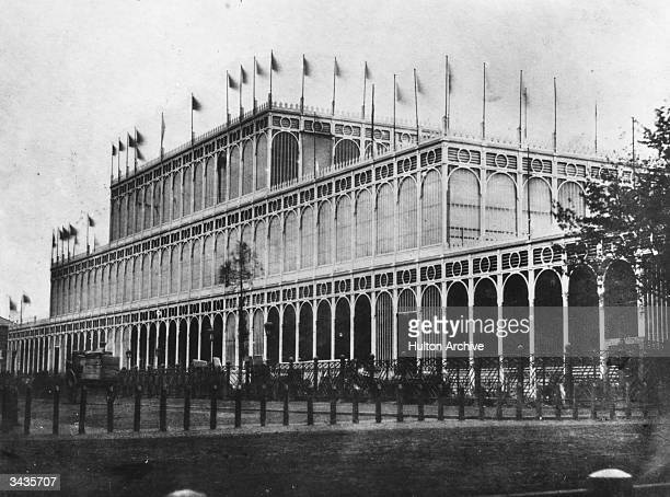 Flags flying on the eastern side of the Crystal Palace in London's Hyde Park The massive iron and glass structure was designed by Sir Joseph Paxton...