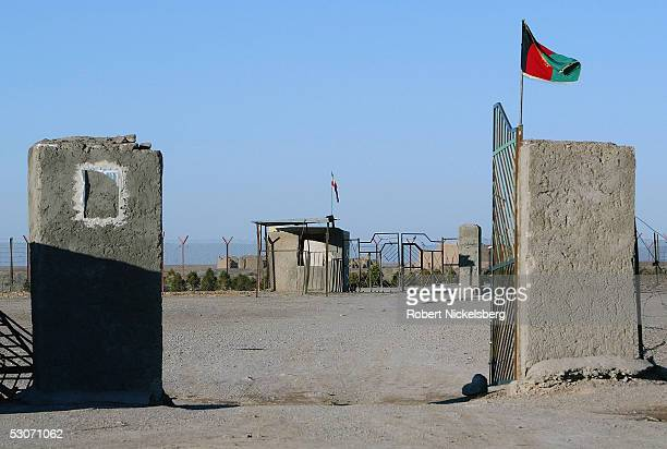 Flags for Afghanistan and Iran fly at the Afghan Iran border at the Kalateyeh Nazar border post February 19 2005 in Kalateyeh Nazar Afghanistan The...