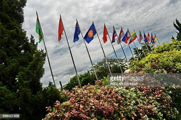 Flags from ASEAN countries and partners flutter outside the ASEAN media centre during the 28th Association of Southeast Asian Nations Summit at the...
