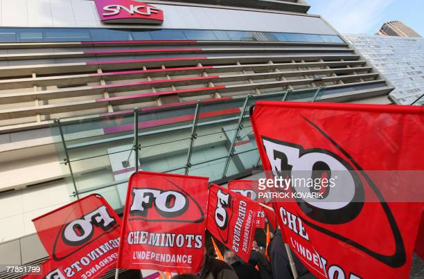 Flags from Force Ouvriere French tradeUnion are displayed as staterun SNCF rail workers protest against the government's planned reform 12 November...