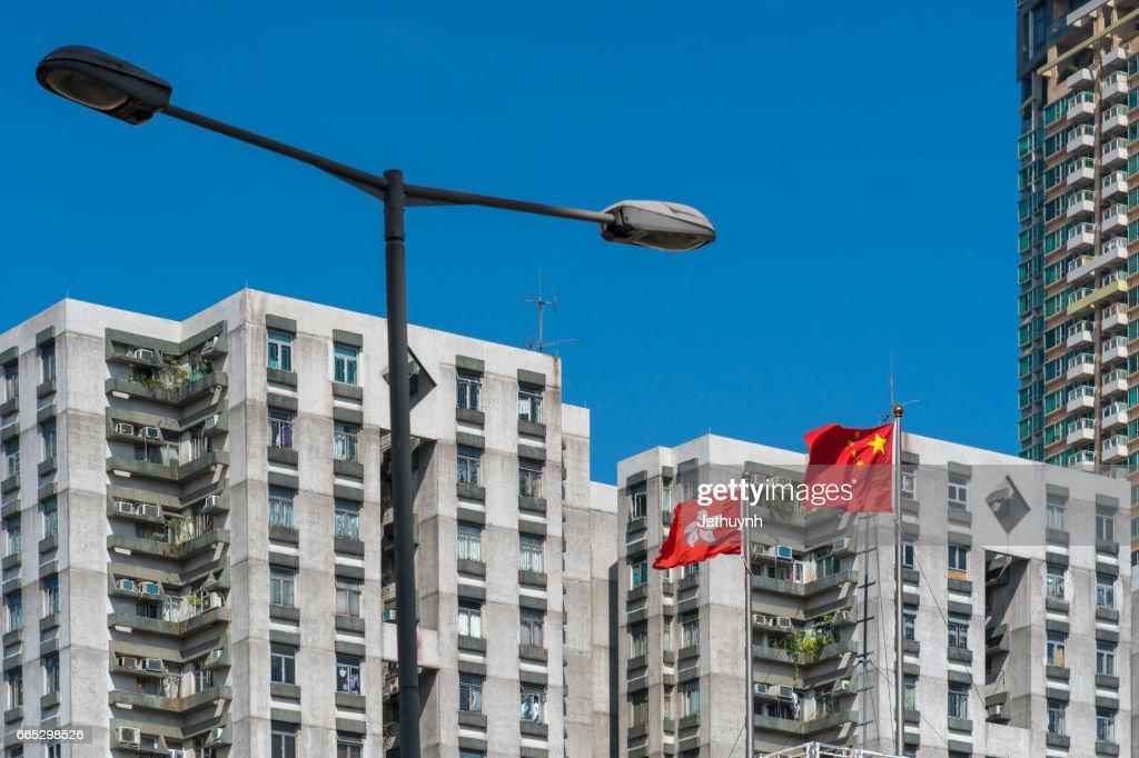 Flags From Hong Kong And China Apartment Stock Photo